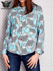Turkusowa wzorzysta koszula z podwijanymi rękawami
