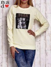Żółta bluza z podwójną naszywką z cekinów