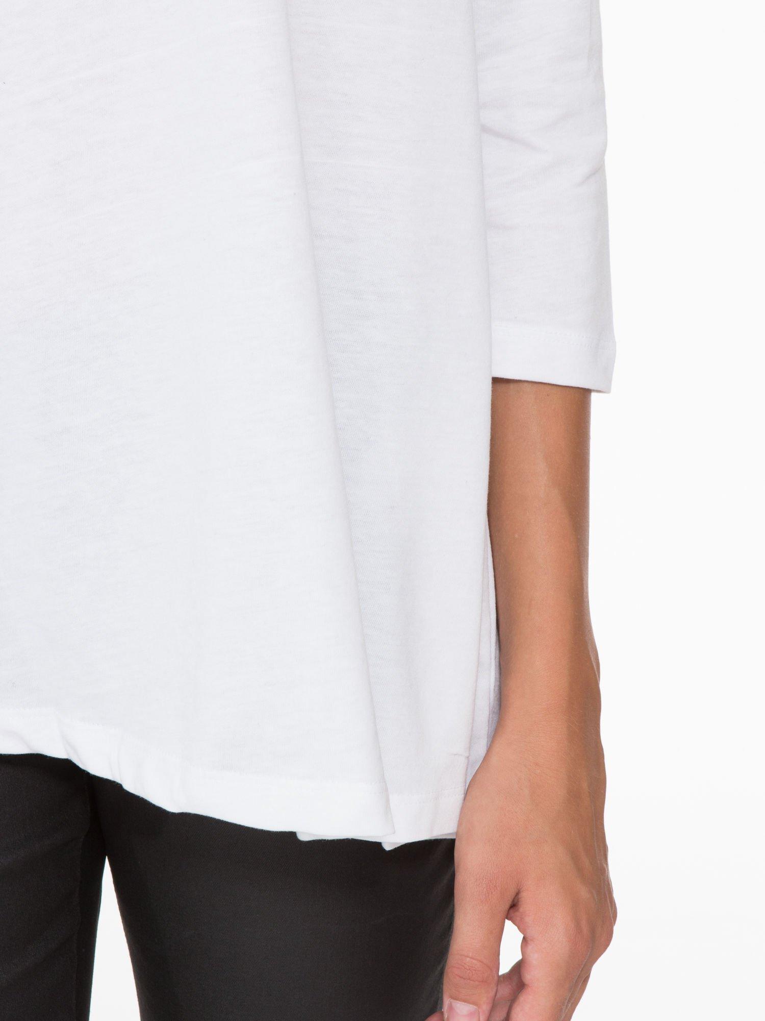 Biała bluzka o rozkloszowanym kroju z rękawem 3/4                                  zdj.                                  7