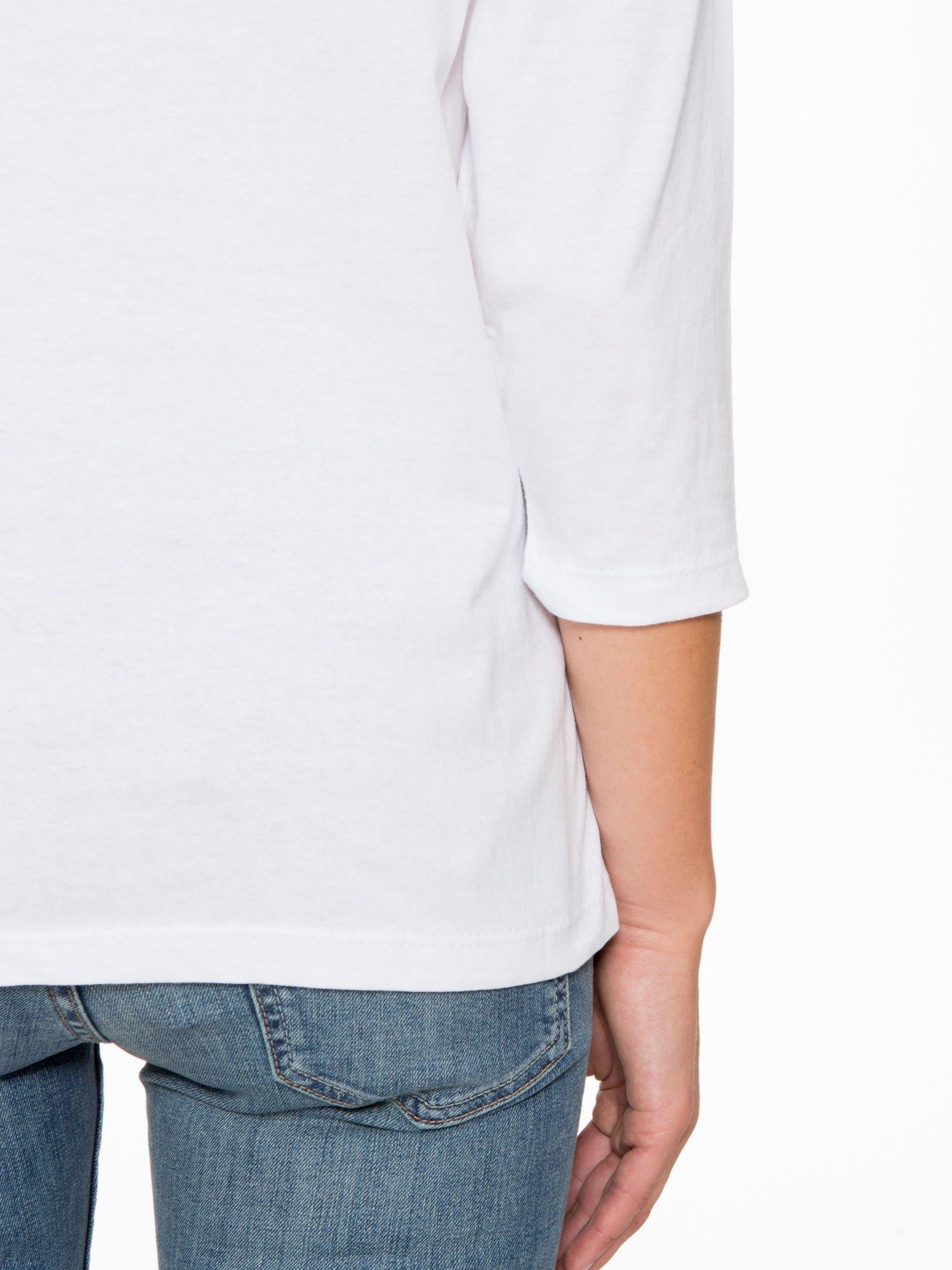 Biała bluzka z nadrukiem kotka i napisem JUST WANNA HAVE FUN?                                  zdj.                                  10
