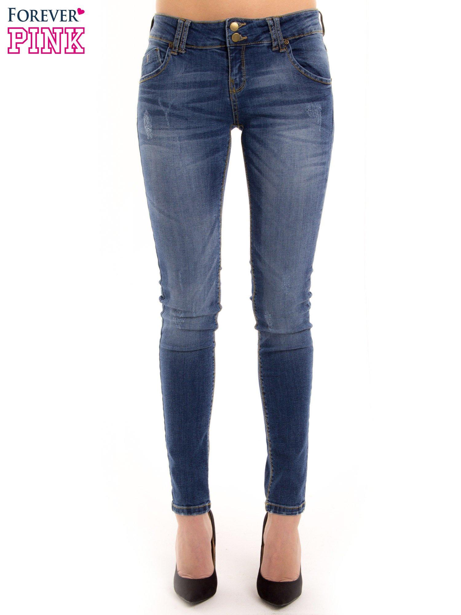 Ciemnieniebieskie jeansy biodrówki na dwa guziki                                  zdj.                                  2