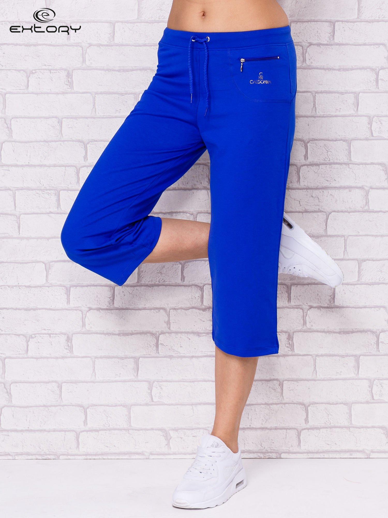Ciemnoniebieskie spodnie sportowe capri                                  zdj.                                  1