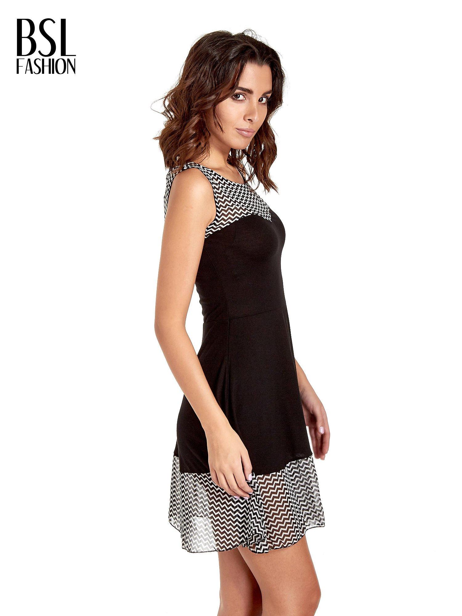 Czarna sukienka z wzorzystą wstawką na górze i falbaną                                  zdj.                                  3