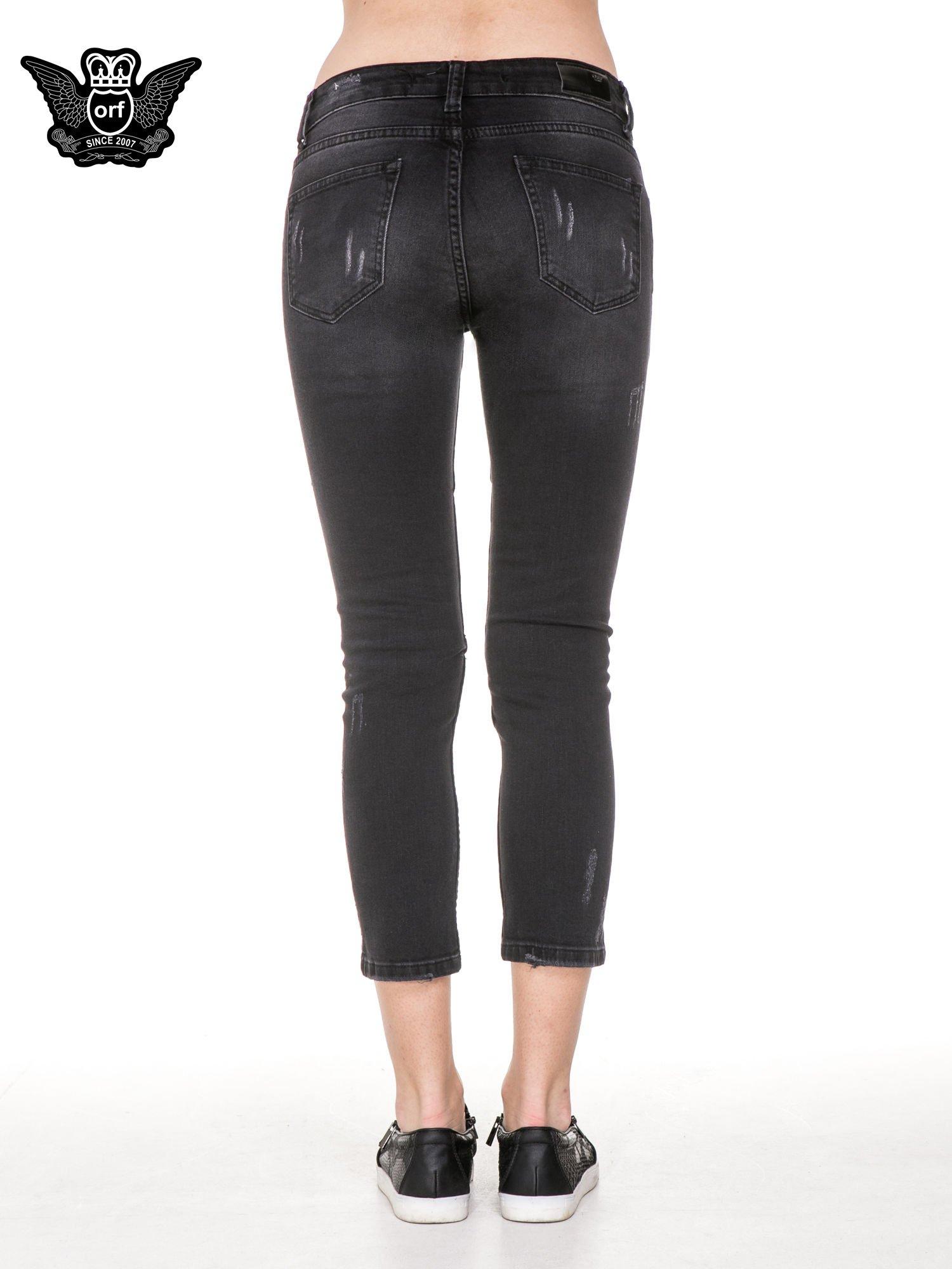 Czarne rozjaśniane spodnie jeansowe 7/8 z rozdarciami                                  zdj.                                  6