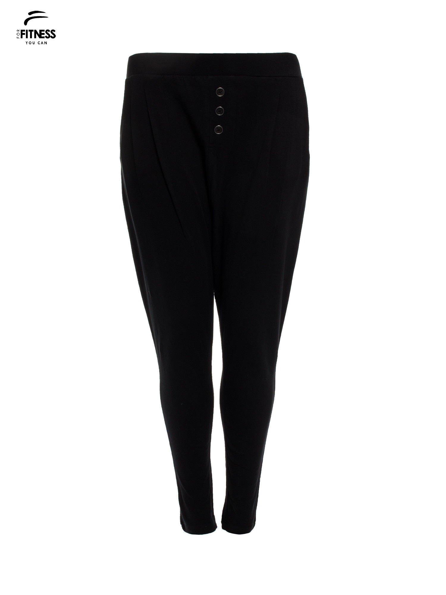 Czarne spodnie dresowe typu baggy z guziczkami                                  zdj.                                  4