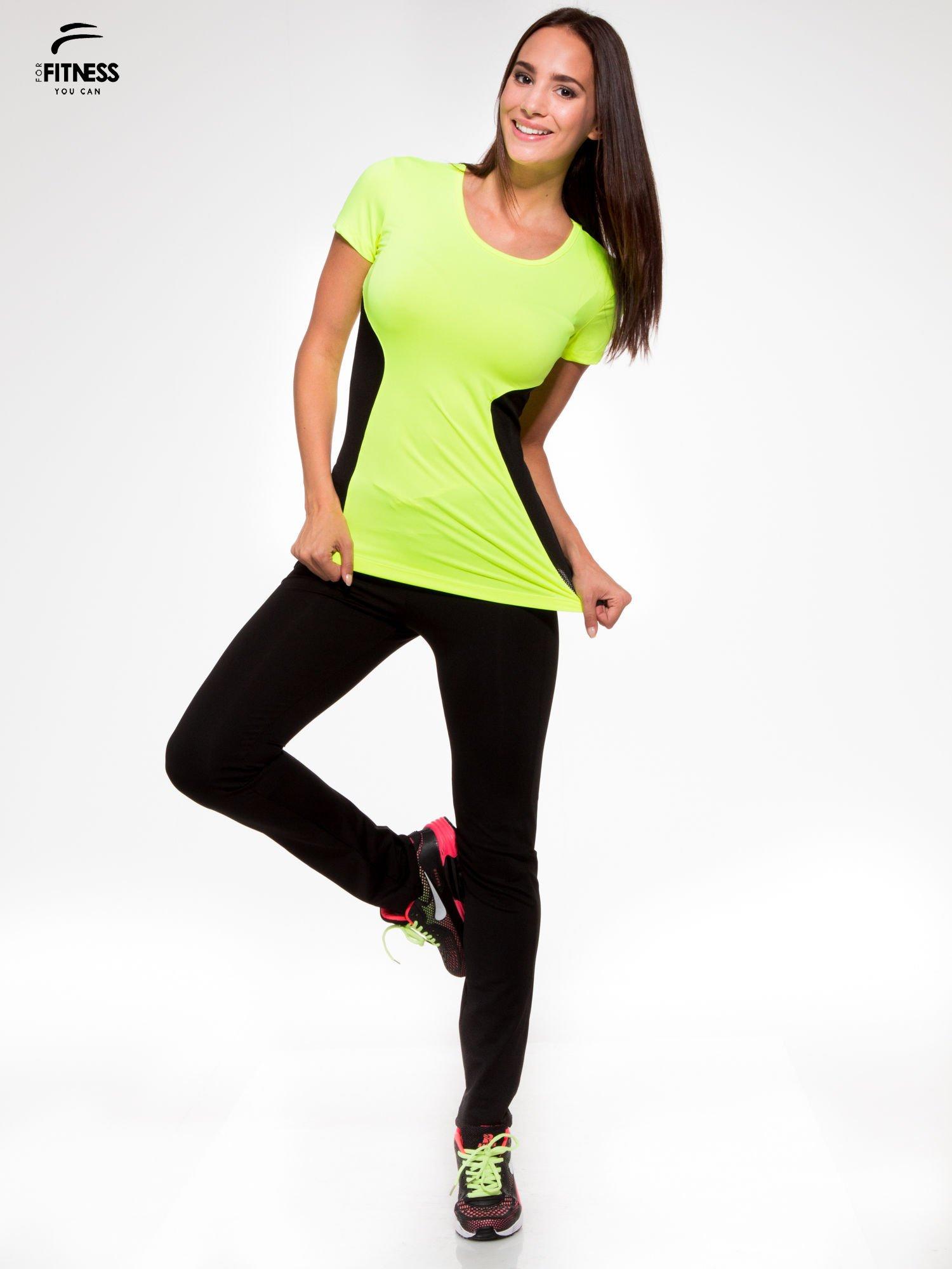 Czarne termoaktywne spodnie do biegania o prostej nogawce z fluozieloną wstawką ♦ Performance RUN                                  zdj.                                  2