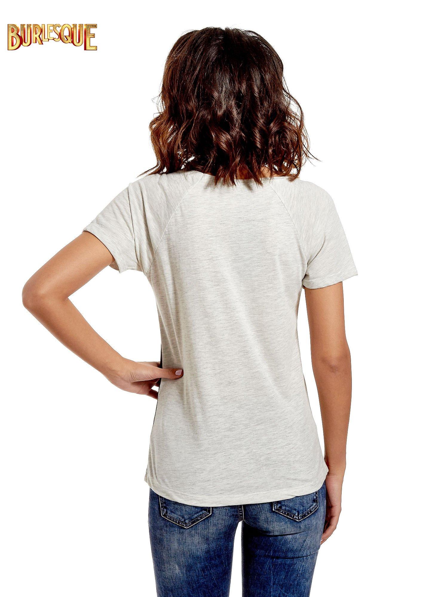 Czarnt t-shirt z kwiatowym nadrukiem i napisem UNREAL                                  zdj.                                  4