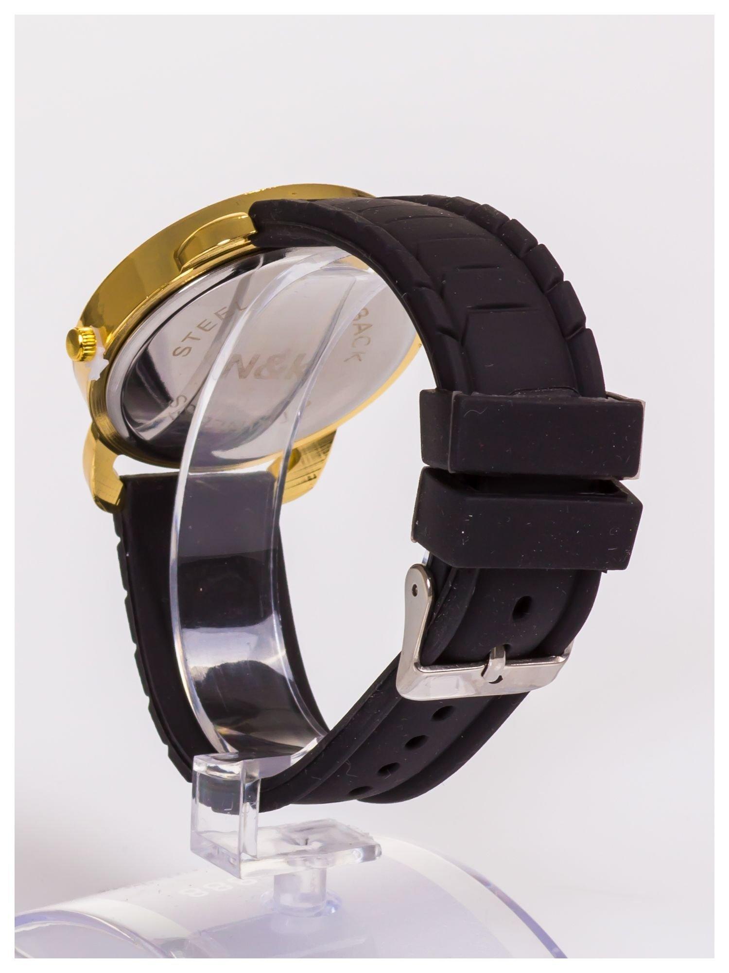 Damski zegarek z cyrkoniami oraz ozdobnym chronografem na dużej tarczy. Wygodny silikonowy pasek.                                  zdj.                                  7