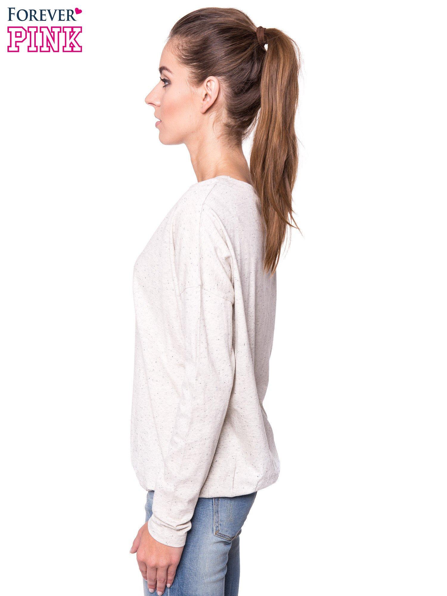 Ecru melanżowa bluzka z gumką u dołu                                  zdj.                                  2