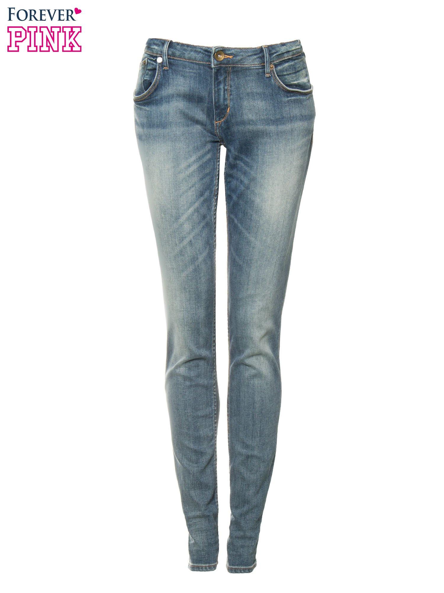 Jasnoniebieskie spodnie jeansowe rurki z cieniowaniem                                  zdj.                                  8