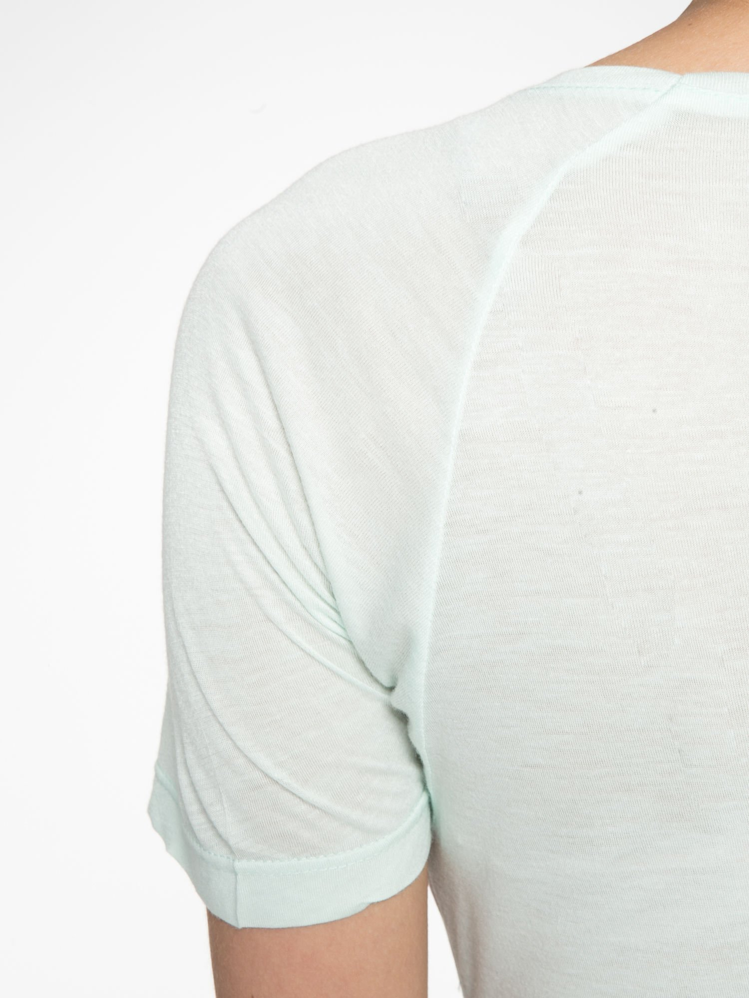 Jasnozielony t-shirt z kwiatowym nadrukiem i napisem UNREAL                                  zdj.                                  10