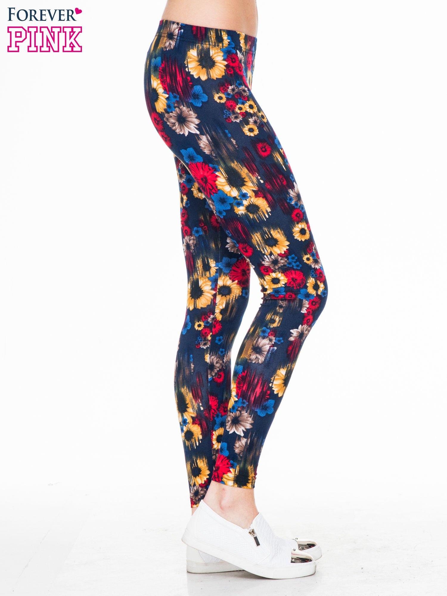 Kwiatowe legginsy w kolorze czerwonym                                  zdj.                                  3
