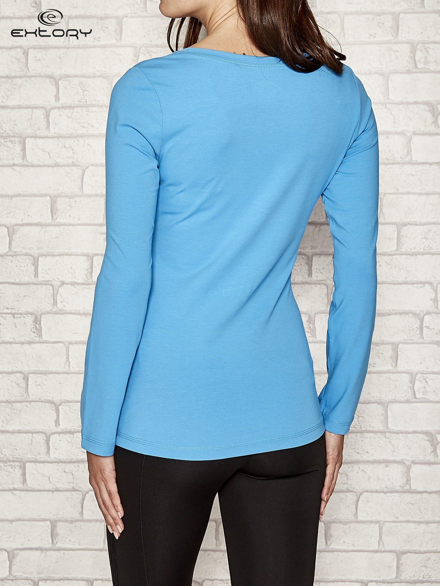 Niebieska gładka bluzka sportowa z dekoltem U PLUS SIZE                                  zdj.                                  3