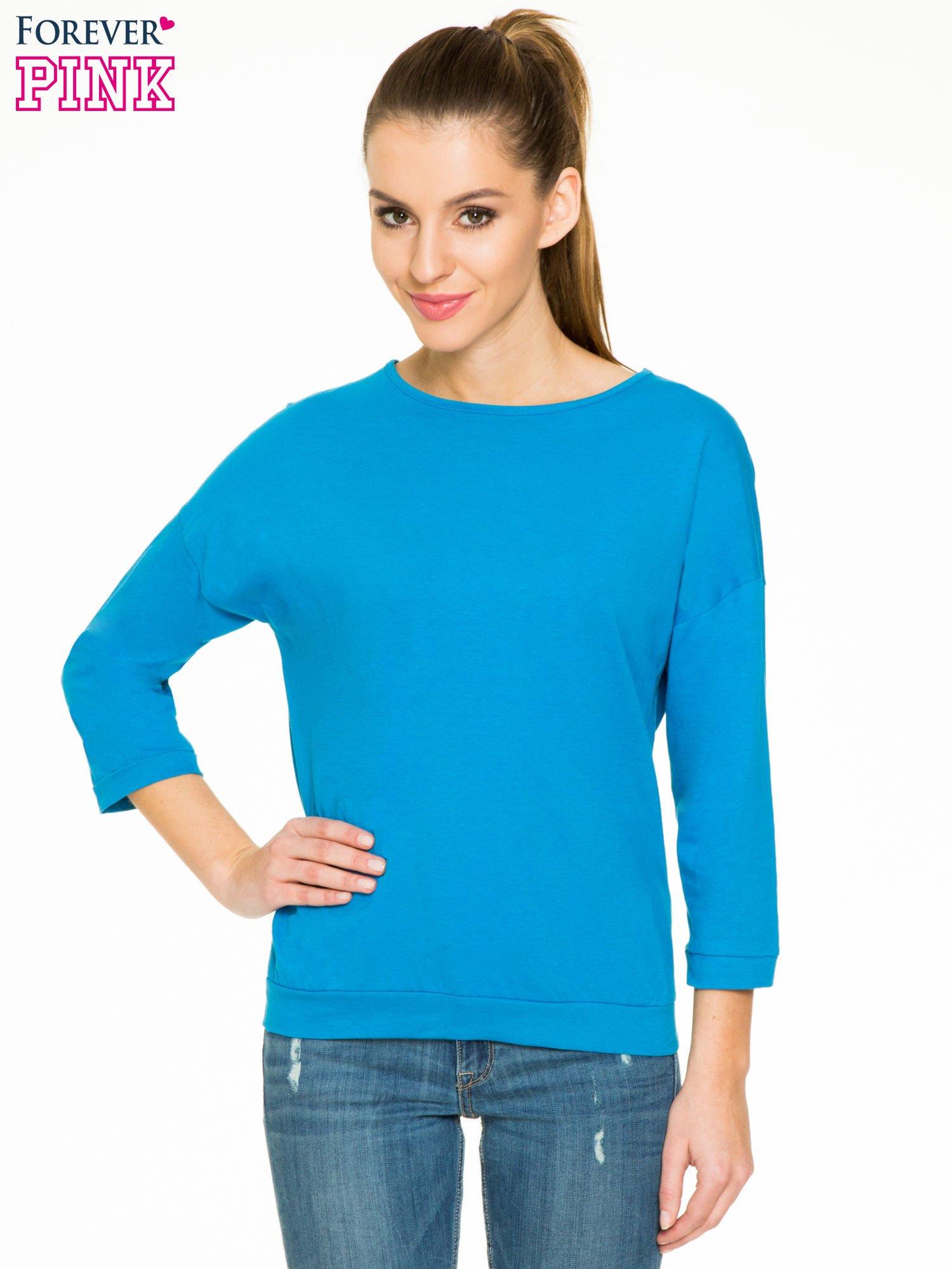Niebieska gładka bluzka z luźnymi rękawami 3/4                                  zdj.                                  1