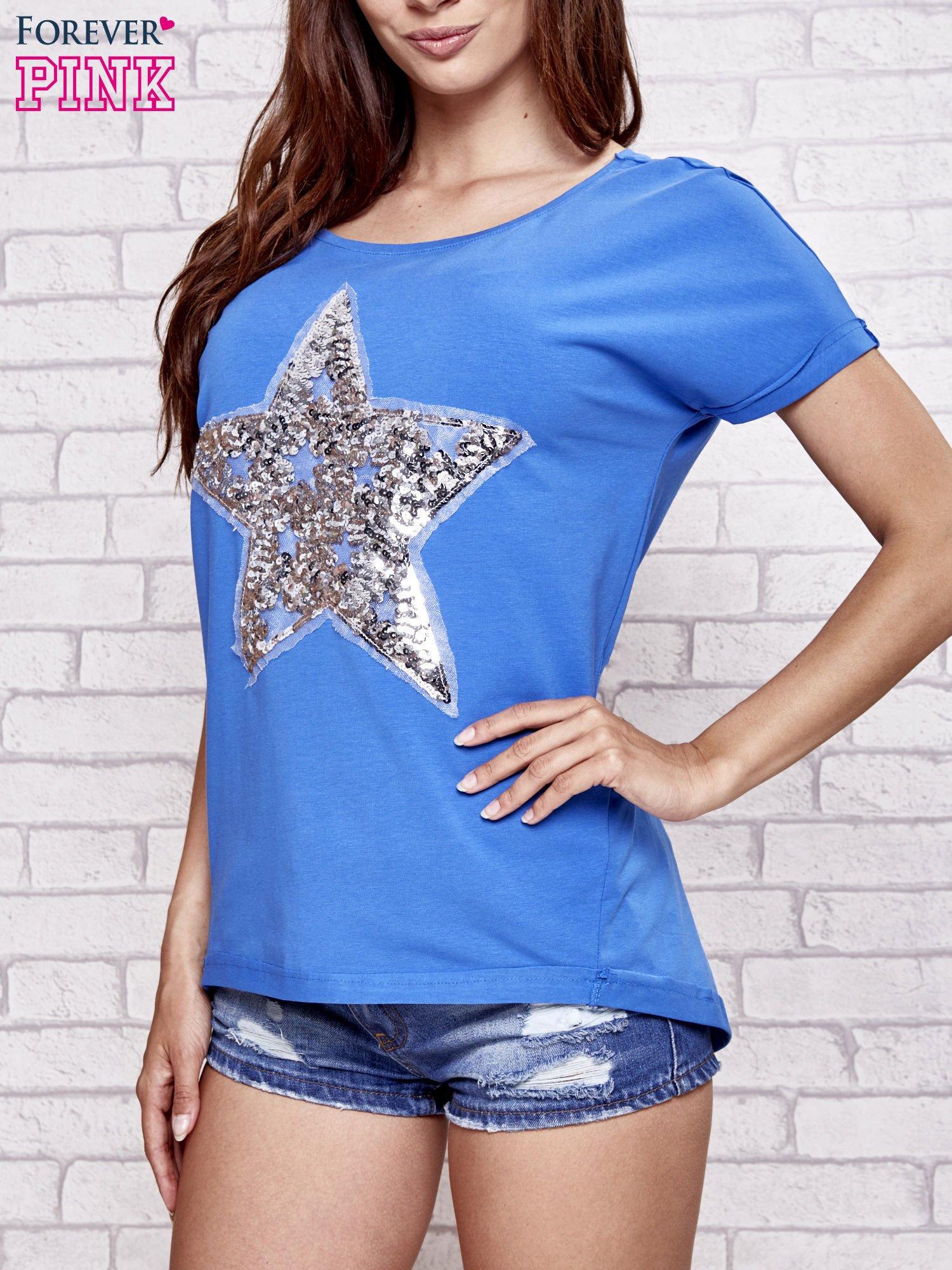 Niebieski t-shirt z gwiazdą z cekinów                                  zdj.                                  1