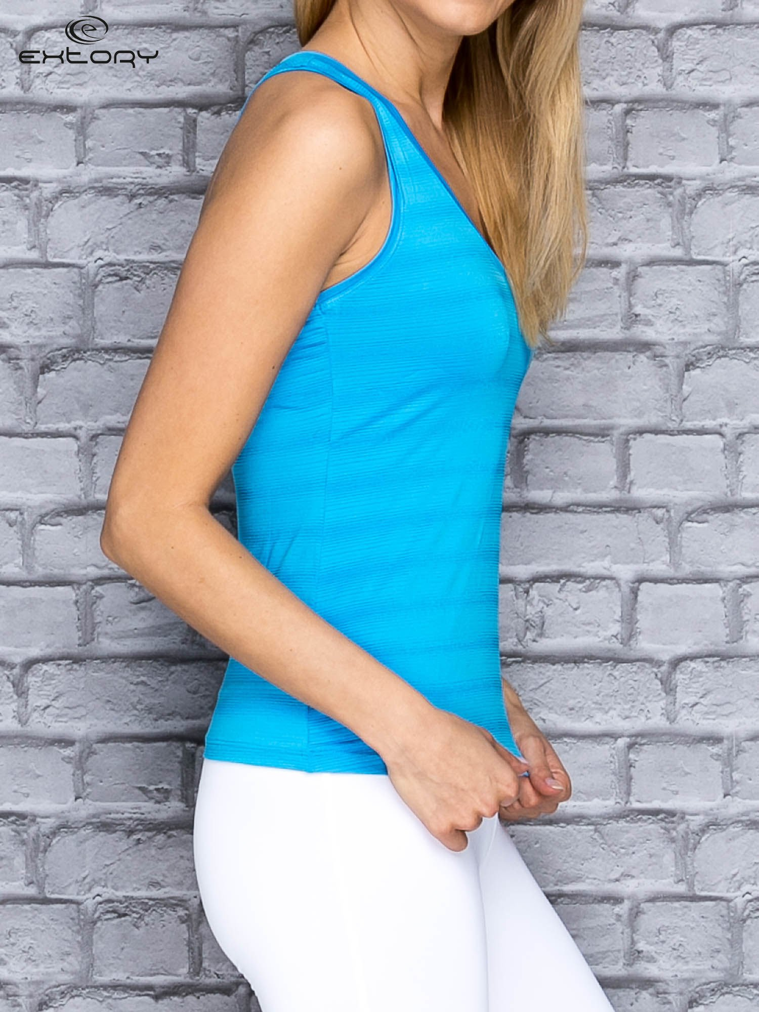Niebieski top sportowy V-neck w paseczki                                  zdj.                                  3