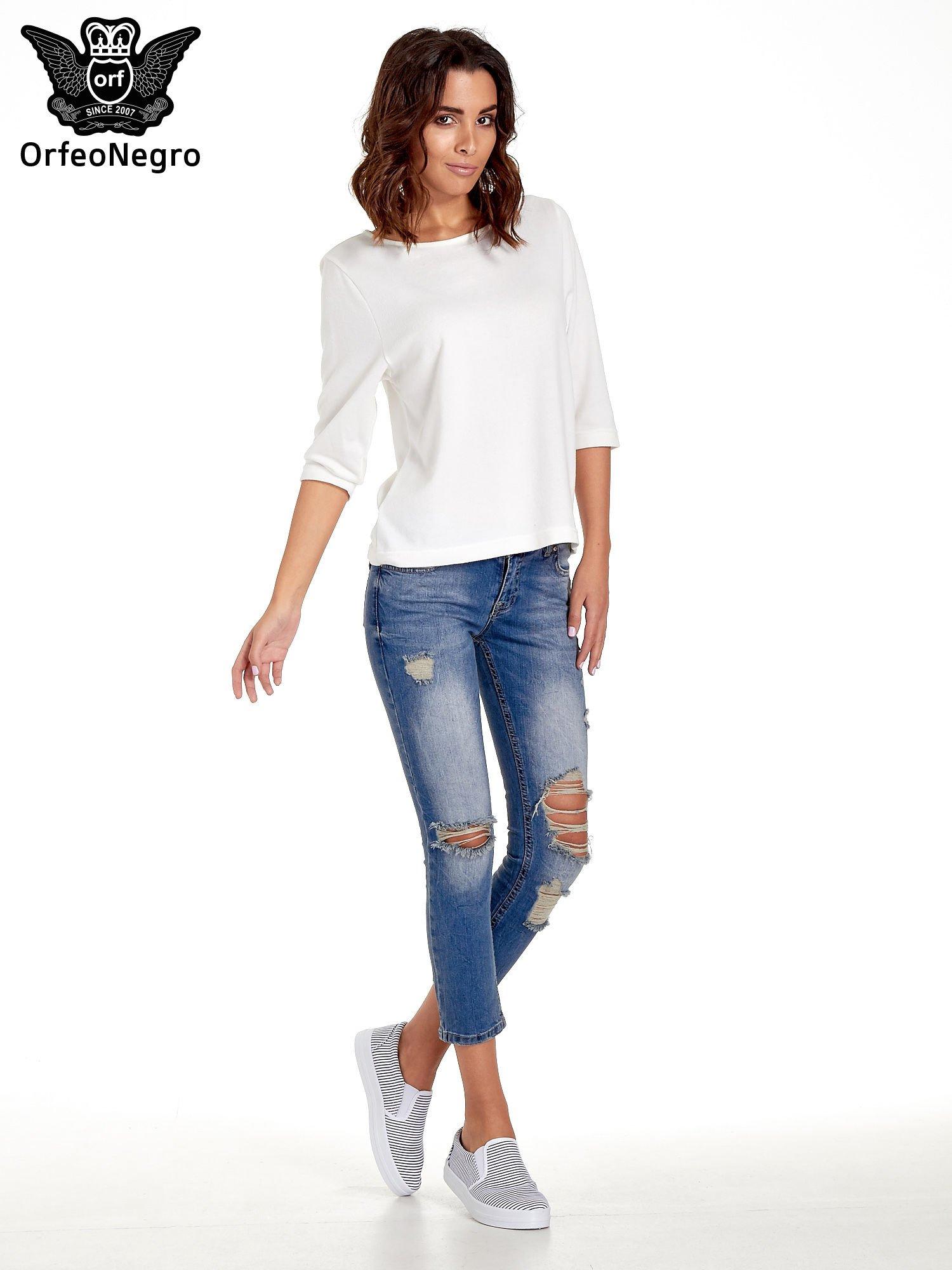 Niebieskie spodnie jeansowe skinny 7/8 z dziuarmi na kolanach                                  zdj.                                  8