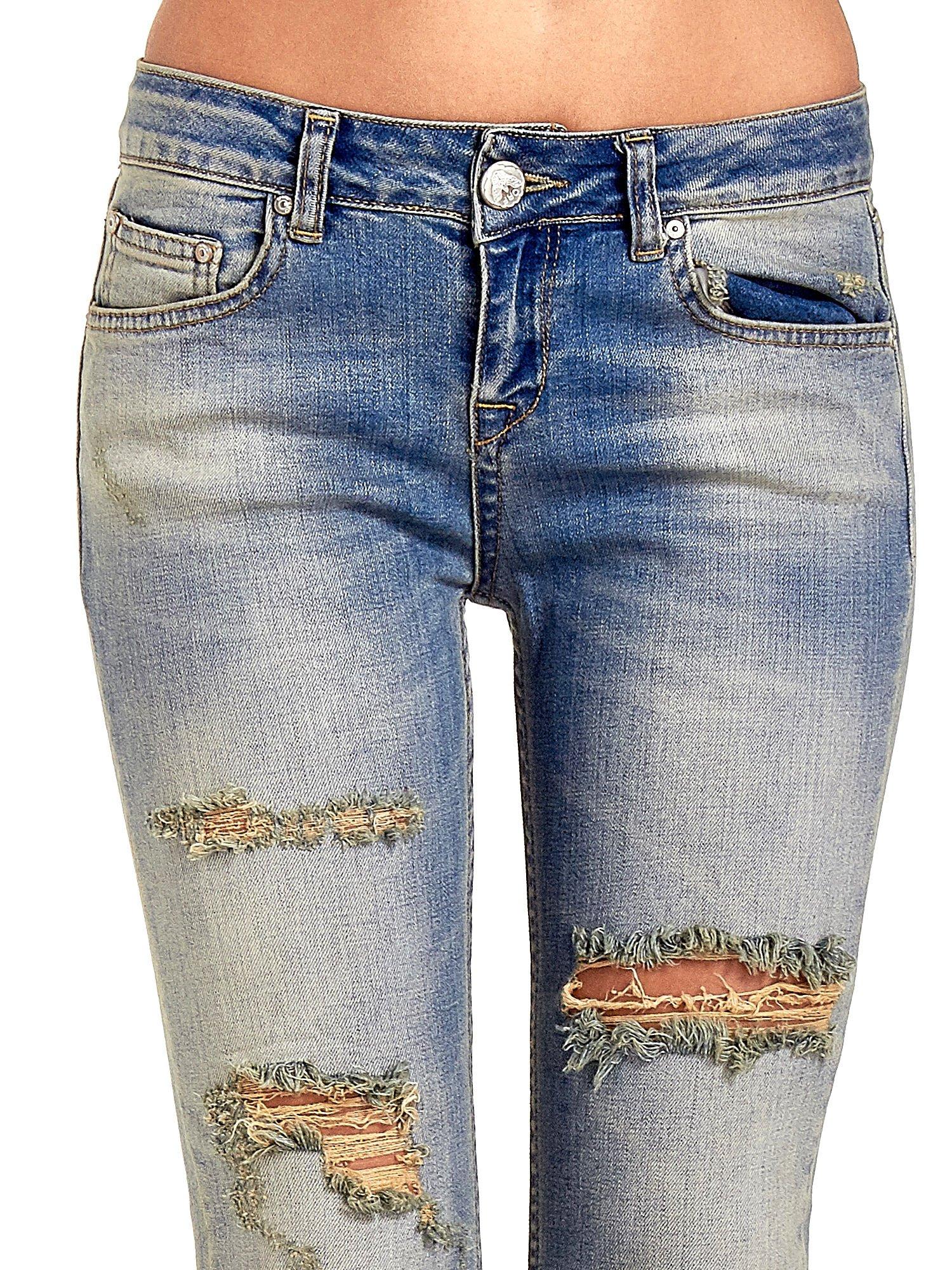 Niebieskie spodnie jeansowe skinny z dziurami                                  zdj.                                  5