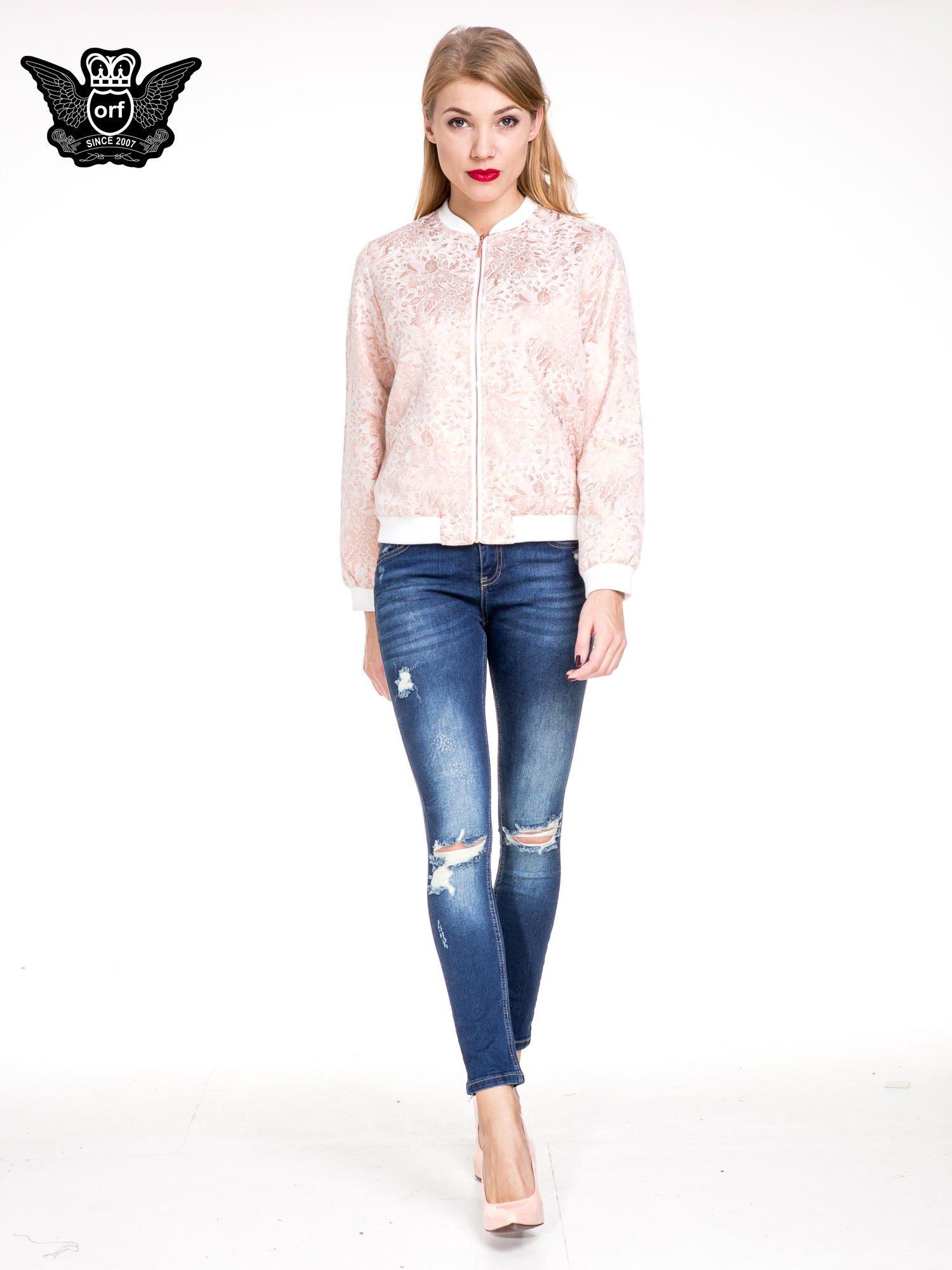 Niebieskie spodnie skinny jeans z rozdarciami na kolanach                                  zdj.                                  2