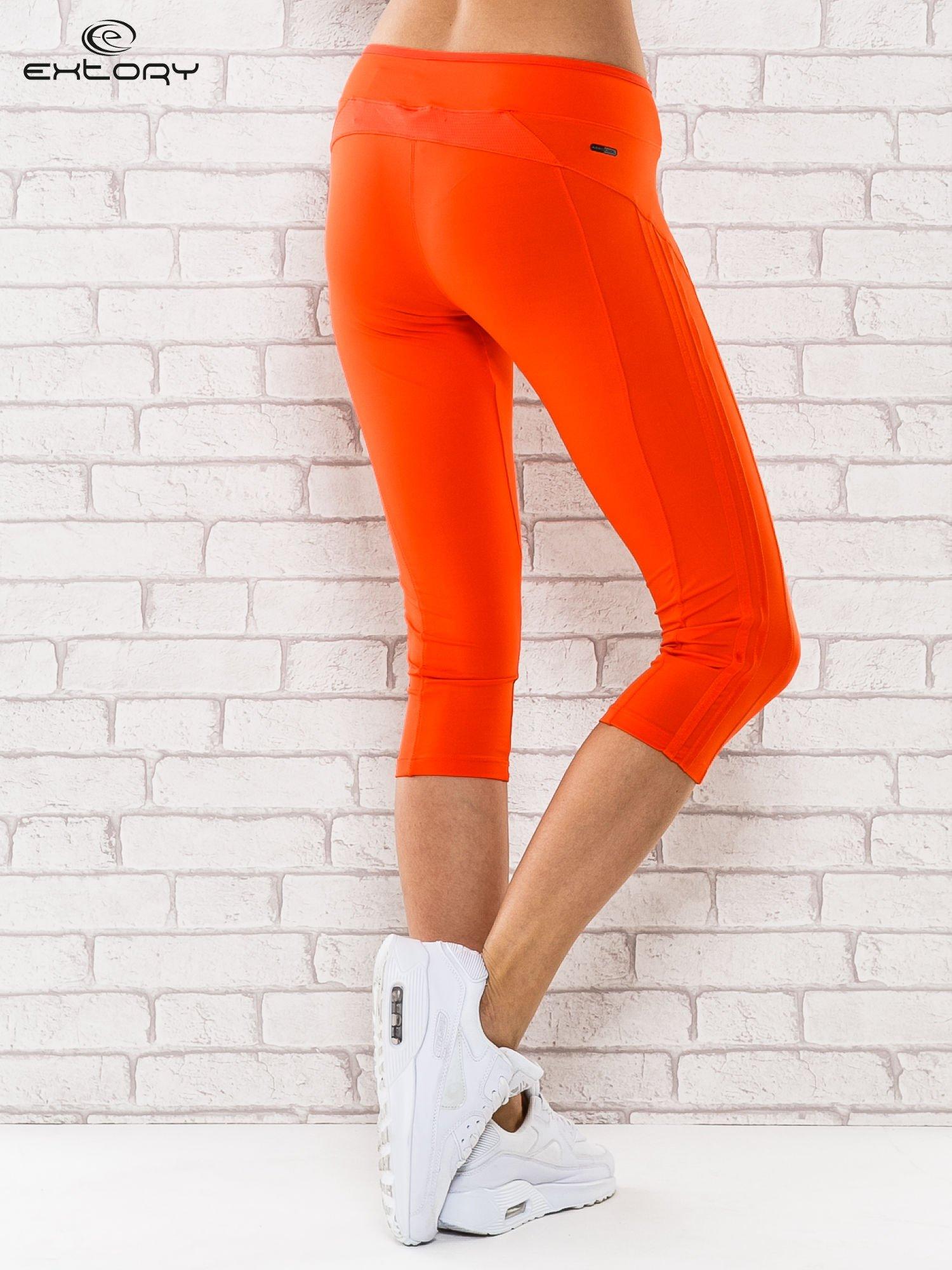 Pomarańczowe legginsy 3/4 sportowe termalne z lampasami                                  zdj.                                  2