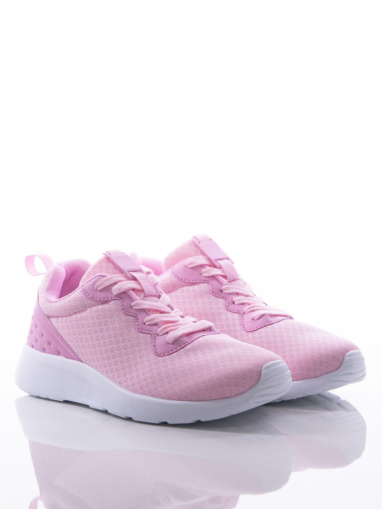 7858747b88efcd 2; Różowe buty sportowe na sprężystej podeszwie z ciemniejszą wstawką na  pięcie ...