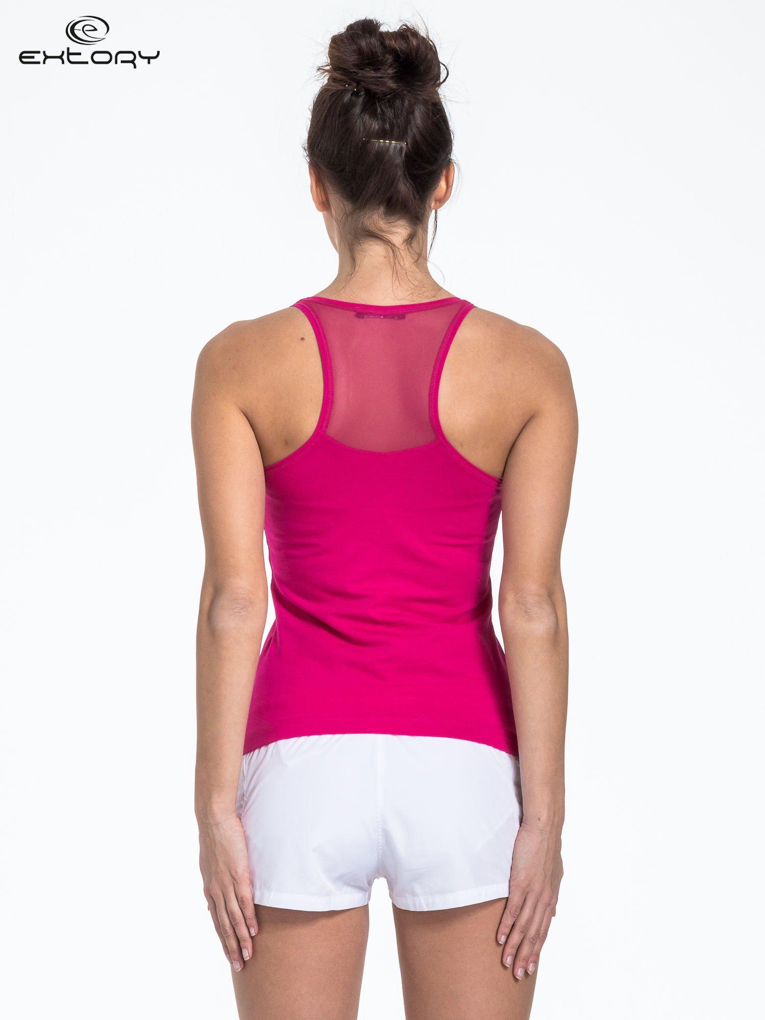 Różowy top sportowy z logo z dżetów                                  zdj.                                  3