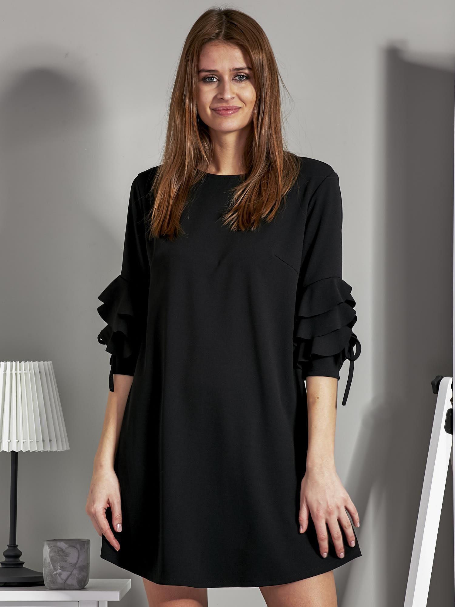 9e0d225cd7 Sukienka trapezowa z falbankami na rękawach czarna - Sukienka koktajlowa -  sklep eButik.pl
