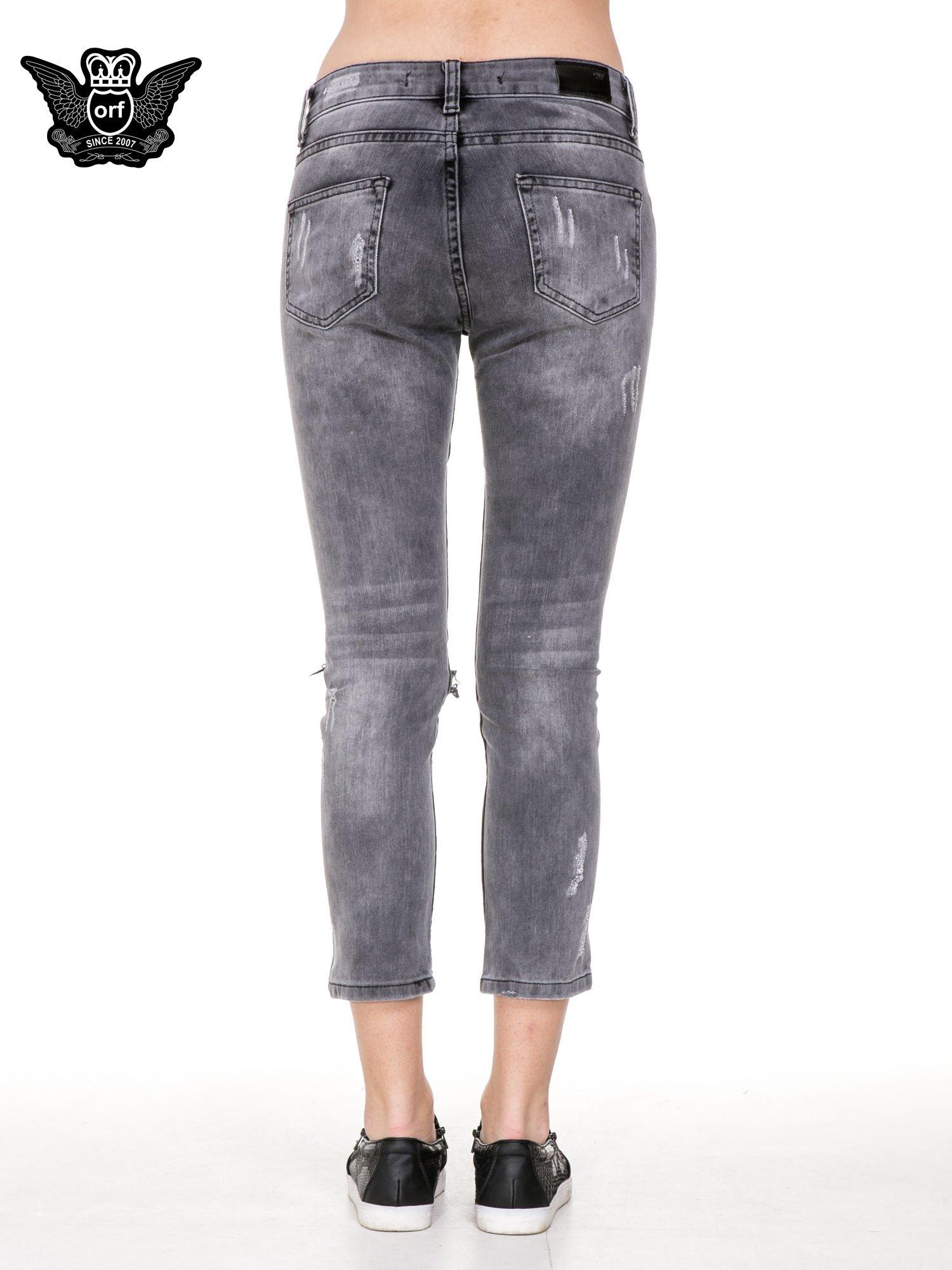 Szare rozjaśniane spodnie jeansowe 7/8 z rozdarciami                                  zdj.                                  6