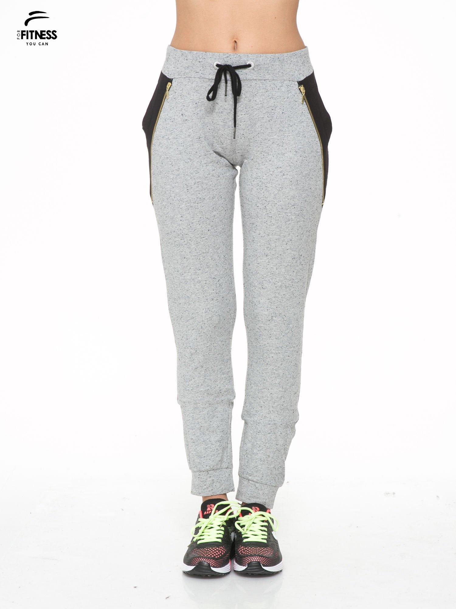 Szare spodnie dresowe damskie z suwakiem i kontrastowymi wstawkami po bokach                                  zdj.                                  1