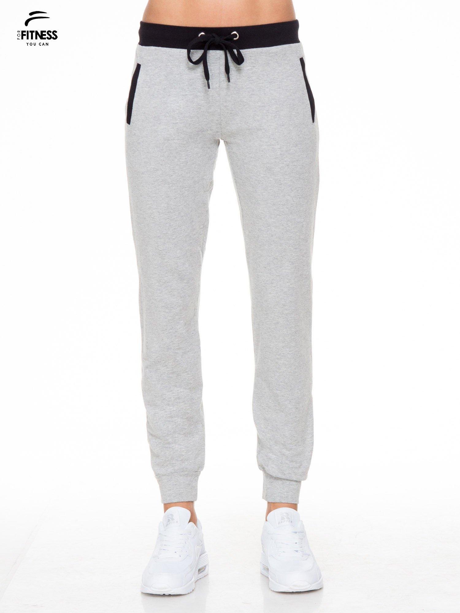 Szare spodnie dresowe z kontrastowym pasem i kieszeniami                                  zdj.                                  1
