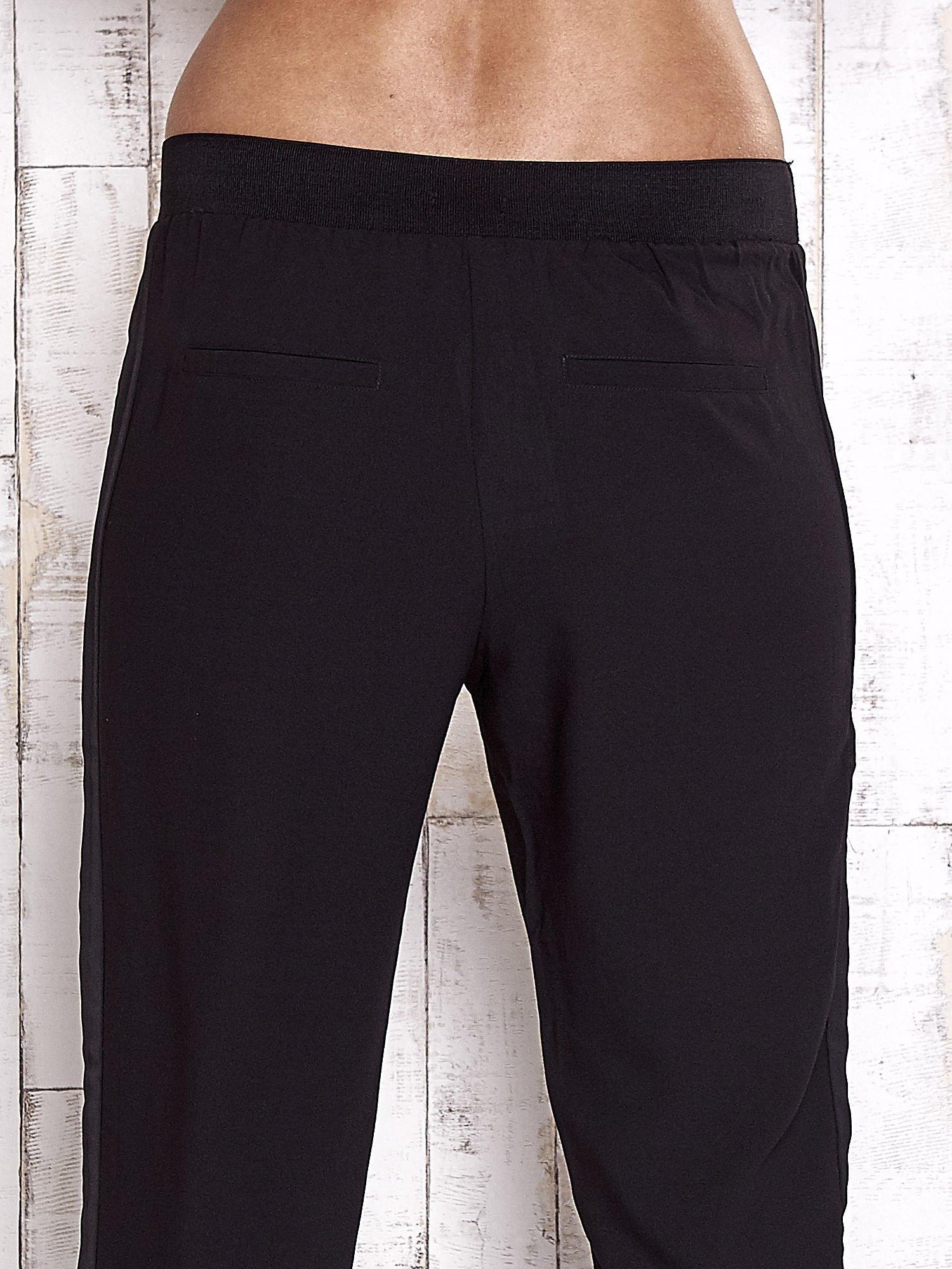 TOM TAILOR Czarne lejące spodnie z lampasem                                  zdj.                                  7