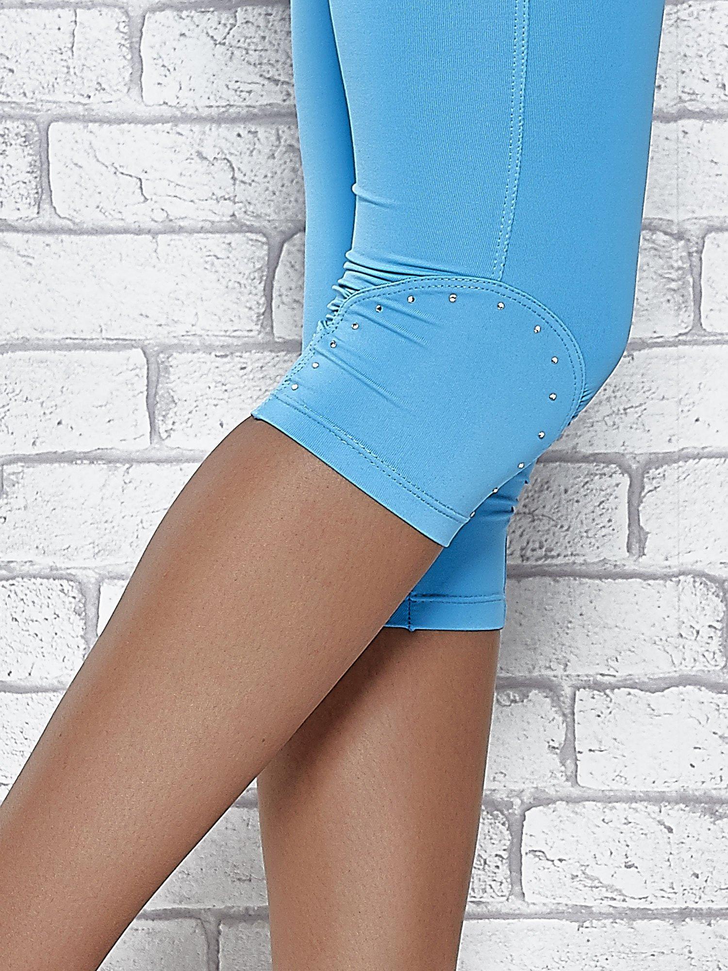 Turkusowe legginsy sportowe termalne z dżetami na nogawkach                                  zdj.                                  7