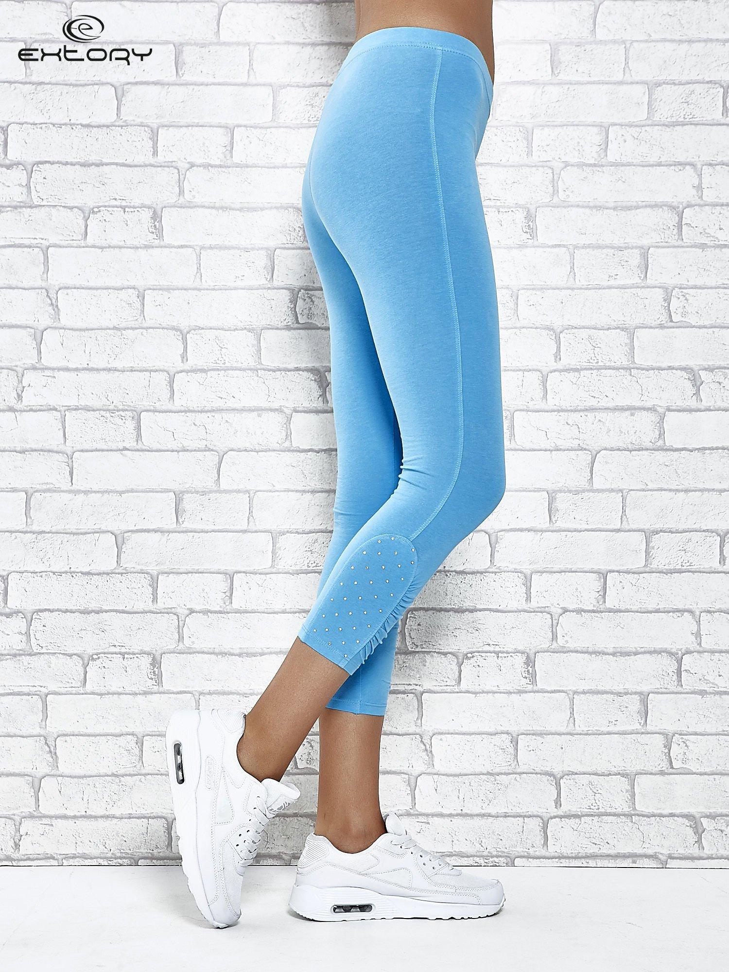 Turkusowe legginsy sportowe z aplikacją z dżetów na nogawkach                                  zdj.                                  3