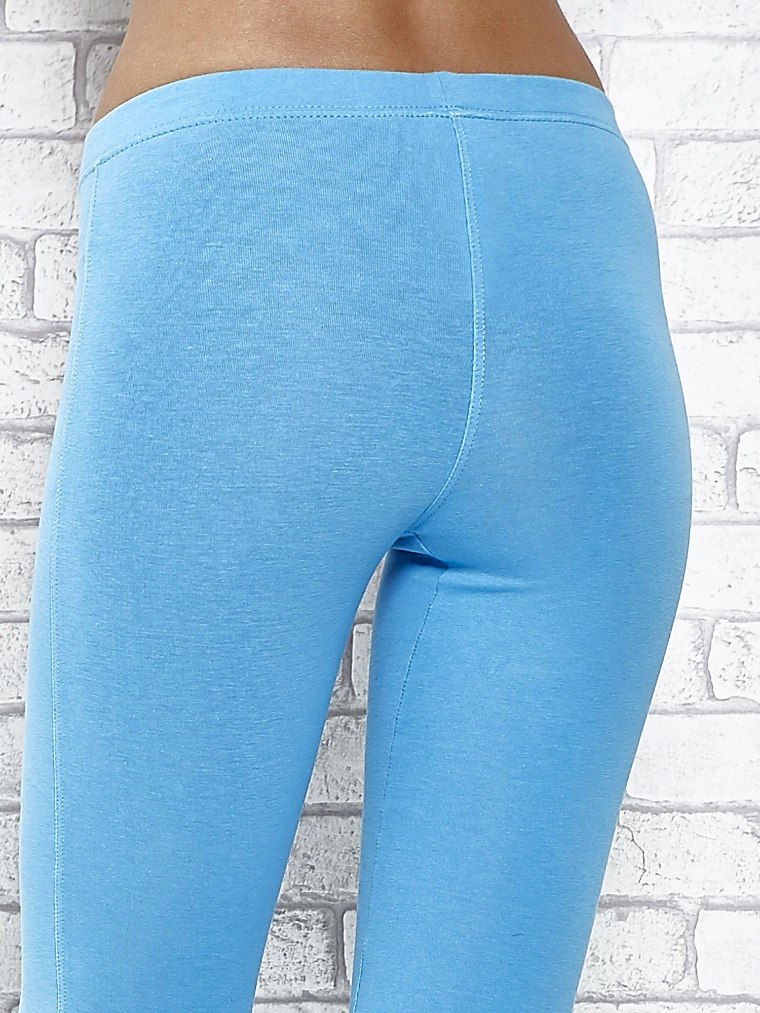 Turkusowe legginsy sportowe z aplikacją z dżetów na nogawkach                                  zdj.                                  5