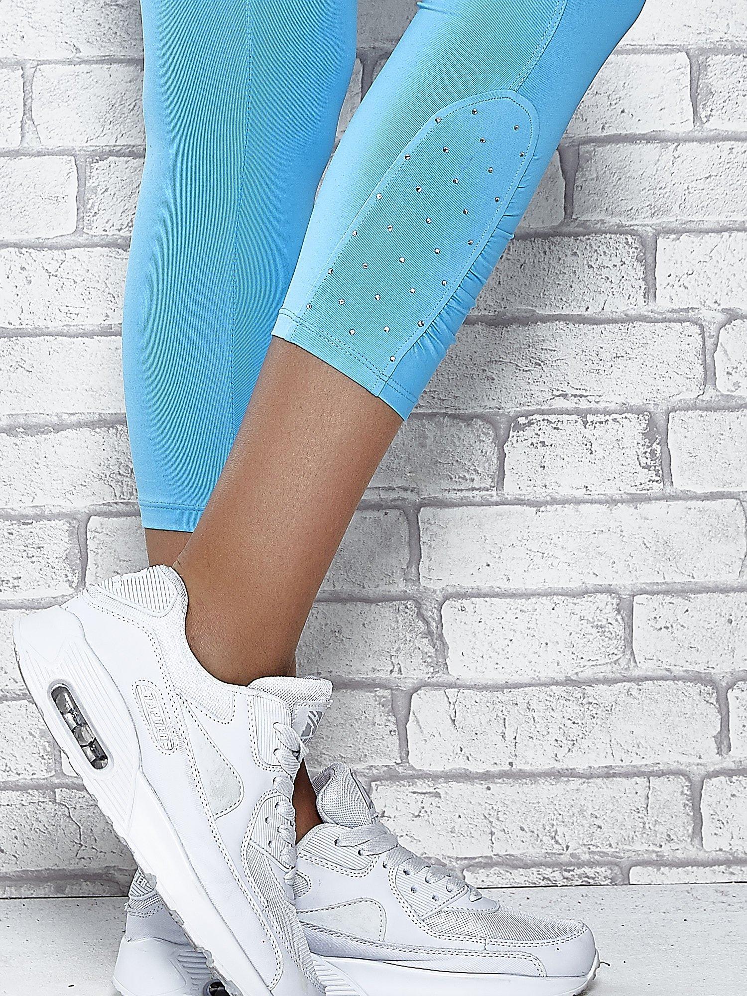 Turkusowe legginsy sportowe z dżetami na dole nogawki                                  zdj.                                  7