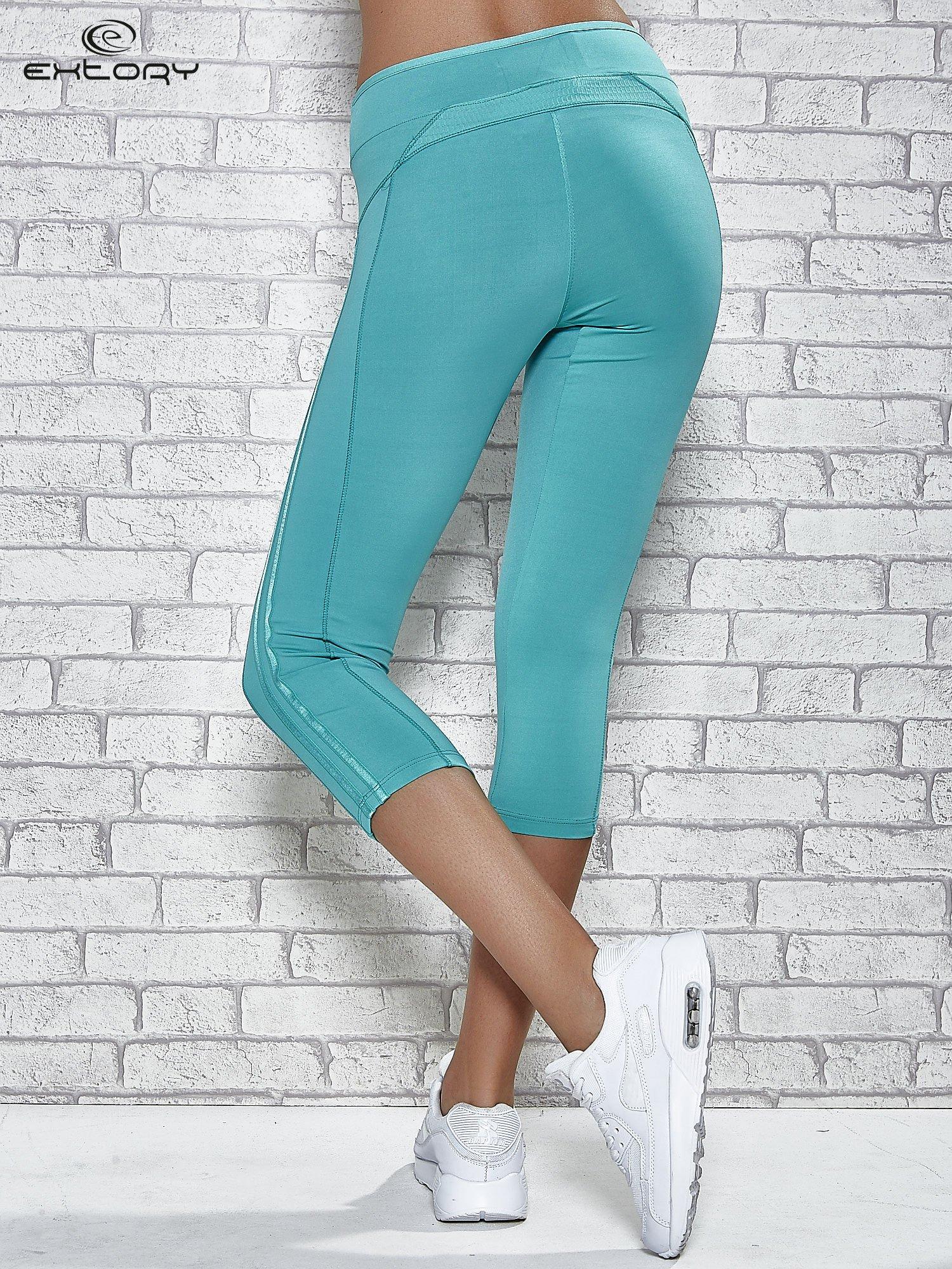 Zielone legginsy 3/4 sportowe termalne z lampasami                                  zdj.                                  3