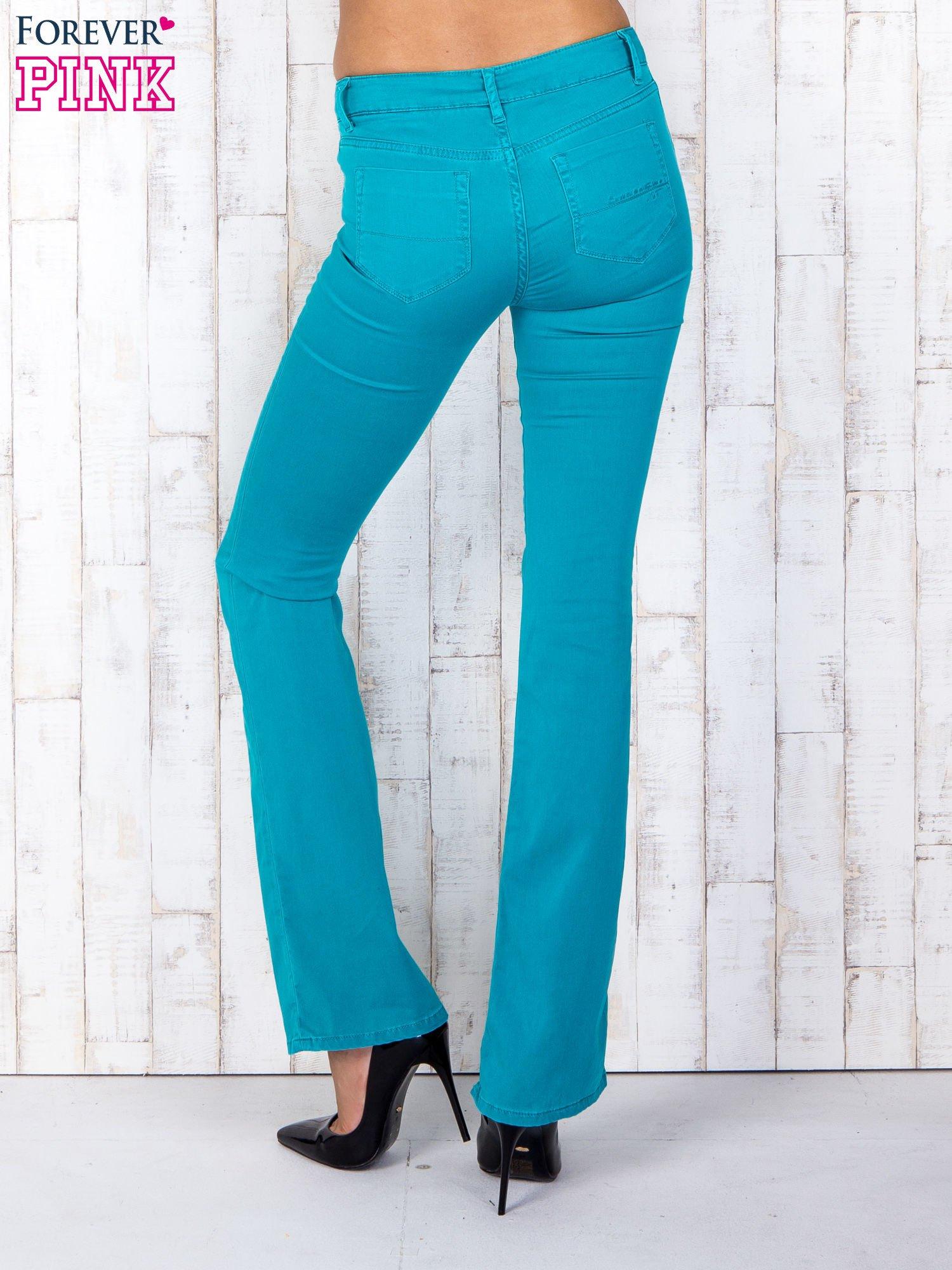 7c1269ae12fad Zielone materiałowe spodnie dzwony - Spodnie z materiału - sklep ...