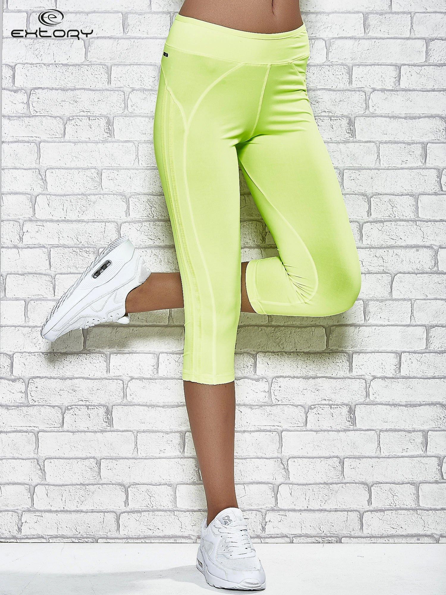 Żółte legginsy 3/4 sportowe termalne z lampasami                                  zdj.                                  1