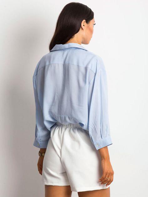 Niebieska bluzka o luźnym kroju                              zdj.                              2