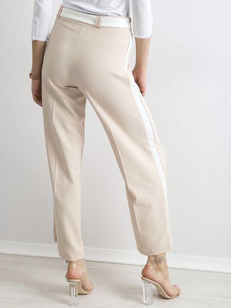 6e7d83f7260add Beżowe szerokie spodnie z lampasami - Spodnie z materiału - sklep ...