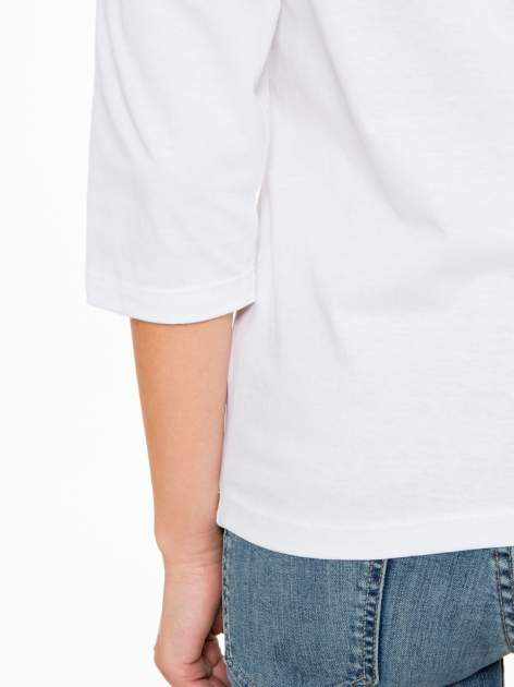 Biała bluzka z napisem FOLLOW YOUR DREAMS                                  zdj.                                  9