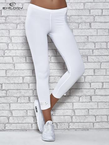 Białe legginsy sportowe termalne z patką z dżetów