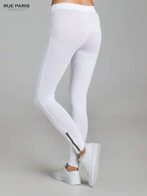 Białe legginsy ze złotymi zamkami                                  zdj.                                  4