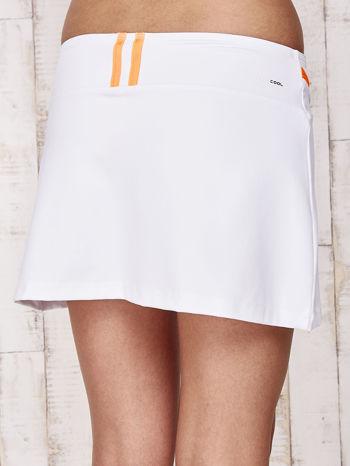 Białe spodenki spódniczka tenisowa z pomarańczowymi wstawkami                                  zdj.                                  8
