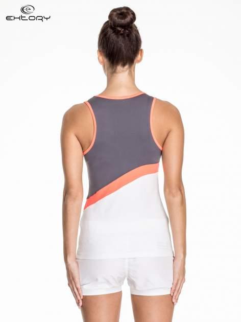Biały damski top sportowy z szaro-koralowym modułem                                  zdj.                                  4
