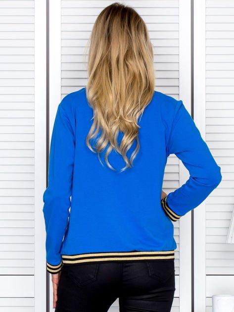 Bluza damska z błyszczącym ściągaczem niebieska                                  zdj.                                  2