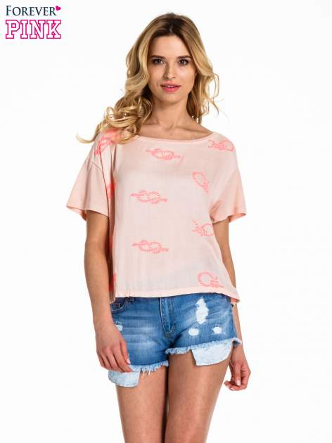 Brzoskwiniowy t-shirt z nadrukiem nieskończoności                                  zdj.                                  1