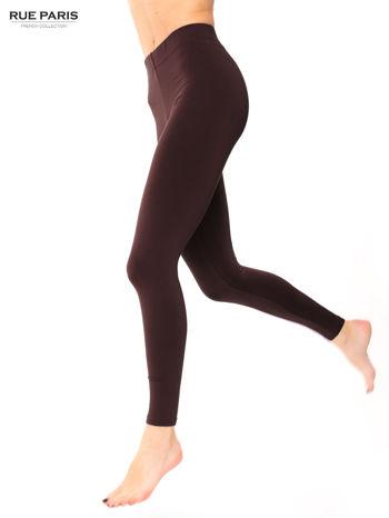 Ciemnobrązowe legginsy bawełniane z gumką w pasie                                  zdj.                                  1
