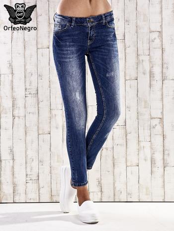 Ciemnoniebieskie marmurkowe spodnie skinny jeans