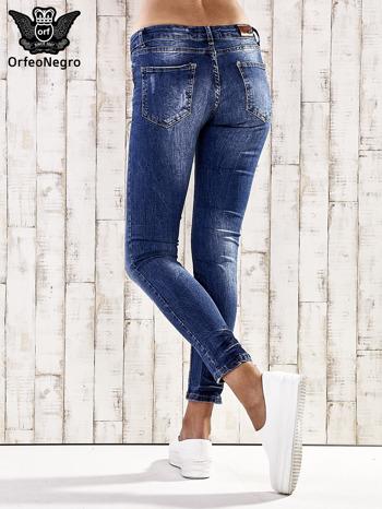 Ciemnoniebieskie marmurkowe spodnie skinny jeans                                  zdj.                                  3